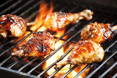 Chicken Legs On The Grill. Photograph of five chicken legs cooked on the grill Royalty Free Stock Image
