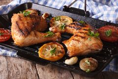 Chicken legs grilled on a grill pan close-up. horizontal Stock Photos