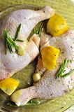 Chicken legs with lemon and rosemary ready to cook Stock Photo