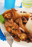 Chicken legs with mushrooms and rice Stock Images
