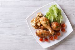 Chicken legs with mushrooms and tomatoes horizontal top view Stock Photos