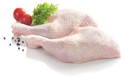 Chicken legs - isolated. Chicken legs next to tomatoes - isolated stock photos