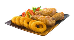 Chicken Legs and Onion Rings Stock Images