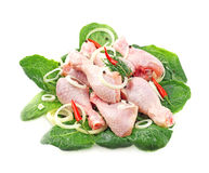 Chicken legs. With onions on a white background Royalty Free Stock Image