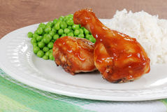 Chicken legs with peas and rice Stock Images