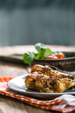 Chicken legs on plate Stock Photography