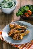 Chicken legs on plate Stock Photo
