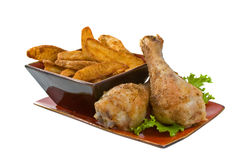 Chicken Legs and Potato Wedges Royalty Free Stock Images