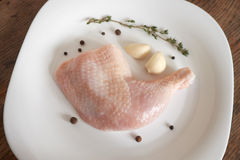 Chicken legs raw. Chicken legs on a white dish with spices Royalty Free Stock Photos