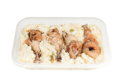 Chicken legs with rice. Over a white background Royalty Free Stock Photography