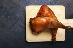 Chicken legs, roasted on a grilled on a black wooden table. Top view. Copy space stock photo