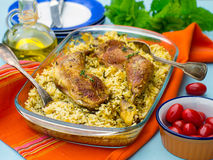 Chicken legs with saffron rice and spices Stock Photography