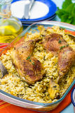 Chicken legs with saffron rice and spices Stock Photo