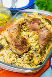 Chicken legs with saffron rice and spices Stock Image