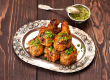 Chicken legs with with spicy sauce stock image