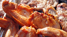 Chicken legs and stake on bbq grill Royalty Free Stock Image