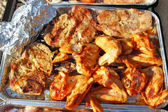 Chicken legs and stake on grill Royalty Free Stock Images