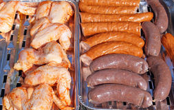 Chicken legs,stake, sausage and black pudding on bbq grill Stock Photo