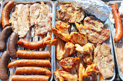 Chicken legs,stake, sausage and black pudding on grill Stock Photography