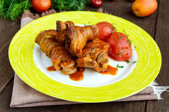 Chicken legs with tomato sauce and marinated tomatoes without skins Royalty Free Stock Photos