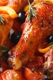 Chicken legs in tomato sauce with vegetables macro vertical Royalty Free Stock Photo