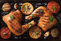 Chicken legs and vegetables on grill pan closeup. Top view horiz Stock Photography