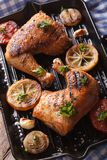 Chicken legs and vegetables on the grill pan vertical top view Stock Photos