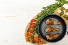Chicken legs with vegetables Royalty Free Stock Image