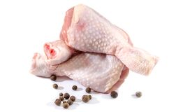 Chicken legs on white background. And pepper peas royalty free stock images