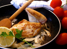 Chicken with lemon. Breast of chicken with lemon and onion stock image