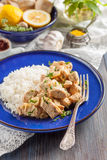 Chicken with lemon, curry, ginger and rice. Eastern, Indian, Asian cuisine Royalty Free Stock Image