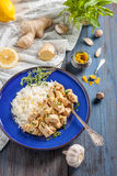 Chicken with lemon, curry, ginger and rice. Eastern, Indian, Asian cuisine Royalty Free Stock Photos