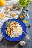 Chicken with lemon, curry, ginger and rice. Eastern, Indian, Asian cuisine Stock Photo