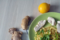 Chicken in lemon ginger sauce with pasta and ruccola Royalty Free Stock Images