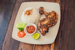 Chicken with lemongrass and rice Balinese dish. Lifestyle stock image