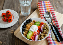 Chicken lentil and tomatoes salad with olives. On a wooden background Royalty Free Stock Photo