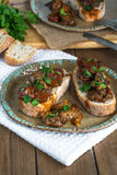Chicken liver and chorizo open sandwich. Garnished with fresh parsley Royalty Free Stock Images