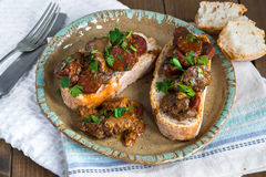 Chicken liver and chorizo open sandwich. Garnished with fresh parsley Royalty Free Stock Image
