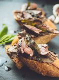 Chicken liver crostinis stock images