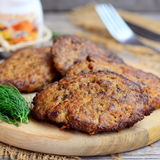 Chicken liver cutlets with carrots and onions. Homemade fried chicken liver cutlets on a wooden board. Simple chicken liver recipe Stock Photos
