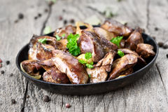 Chicken liver in frying pan Royalty Free Stock Photography