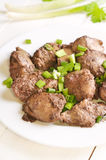 Chicken liver with green onion Stock Photo