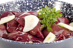 Chicken liver with onion slices Stock Photos