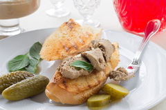 Chicken liver pate. Slice of toasted baguette with liver pate and gherkins Stock Image
