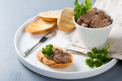 Chicken liver pate on bread and in bawl Stock Image