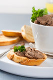 Chicken liver pate on bread and in bawl Stock Images