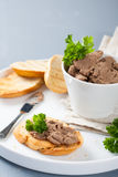 Chicken liver pate on bread and in bawl Royalty Free Stock Image