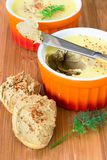 Chicken liver pate with butter in ramekin. Homemade chicken liver pate with butter in ramekin. Wooden background. Sandvich Baguette with liver pate. Vertical Royalty Free Stock Images