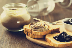 Chicken liver  pate in a glass jar and toasted bread Stock Image