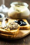 Chicken liver  pate in a glass jar and toasted bread Royalty Free Stock Photo